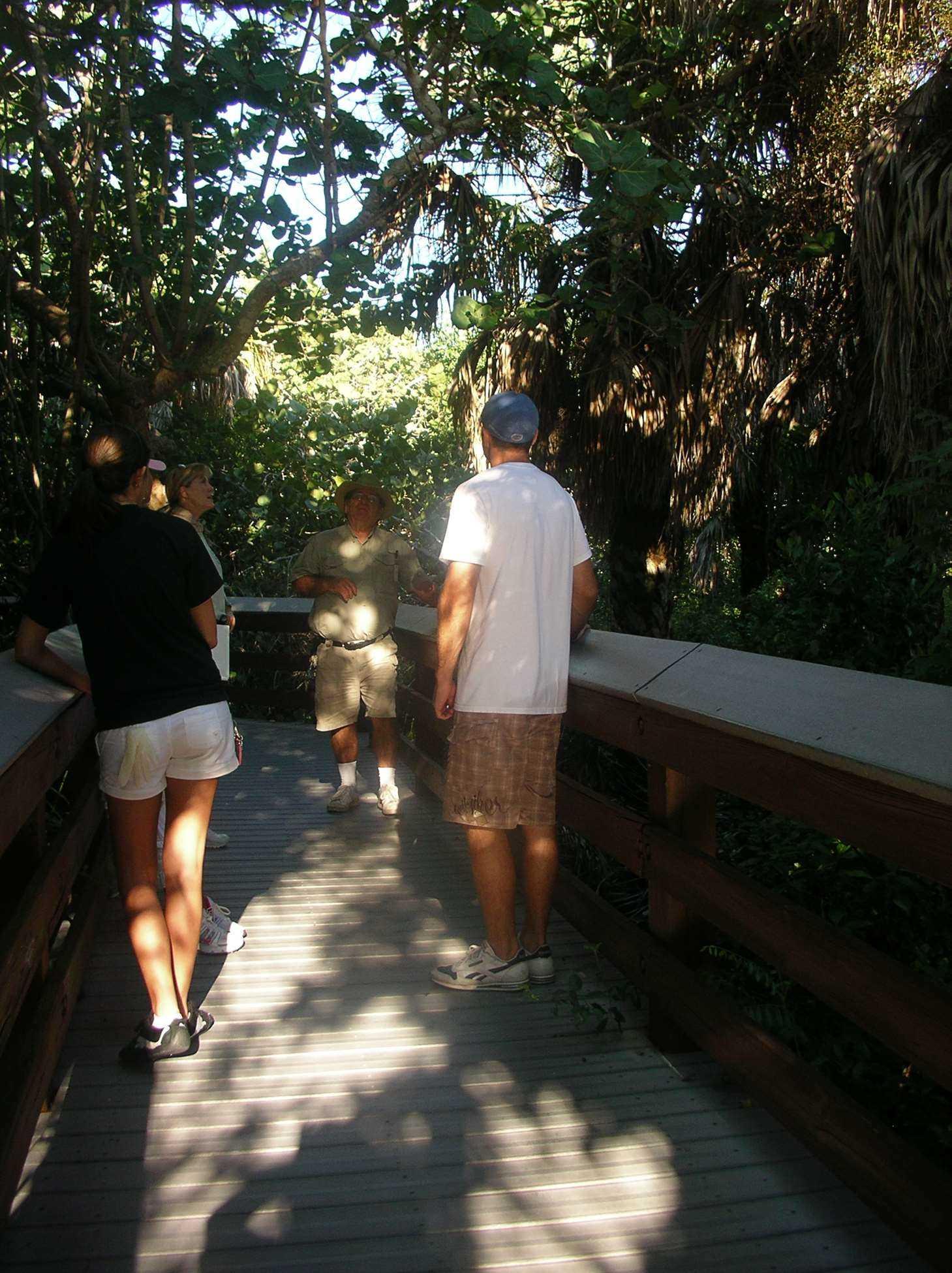 ranger does nature talk on boardwalk with volunteer